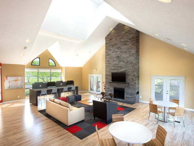 This image shows the resident lounge door view featuring the Flat-screen TV and fireplace.