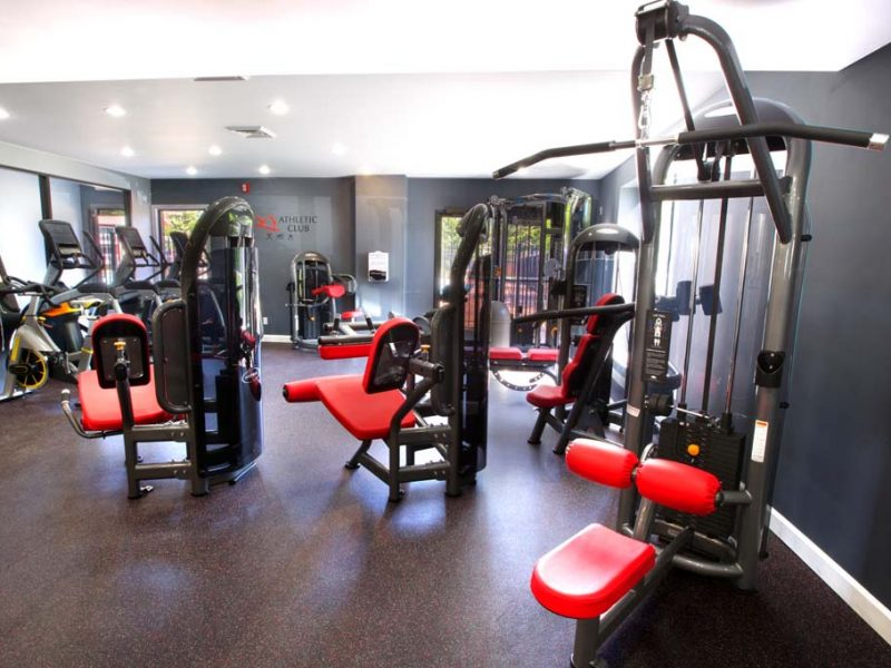 This image shows an expansive view of the fitness gym equipment featuring the yoga and spin studio with an indoor cycling mirror that was ideal for flexibility and strength exercise.