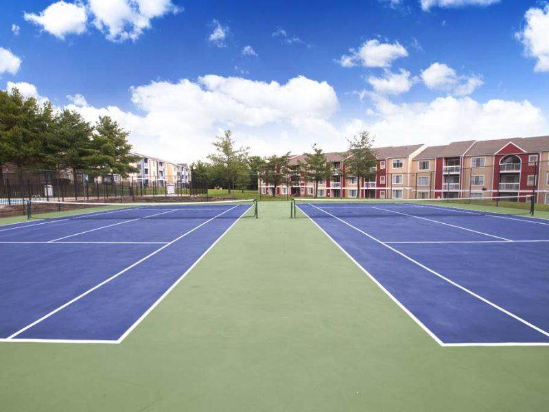 This image shows the two lighted tennis court in TGM Sudley Crossing that was ideal for sports recreation.